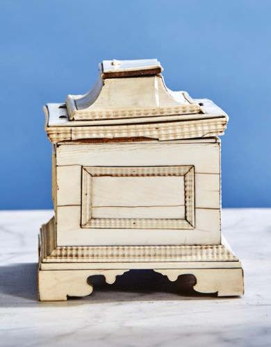 Ivory veneer box. Lid with doucine concealing a drawer, faces with panels of gui…