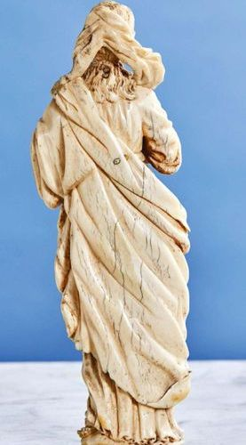 Virgin of Calvary in ivory carved in the round. The Virgin crosses her hands in …