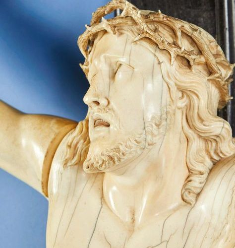 Large crucifix with live Christ in carved ivory and blackened wood cross. Head c…