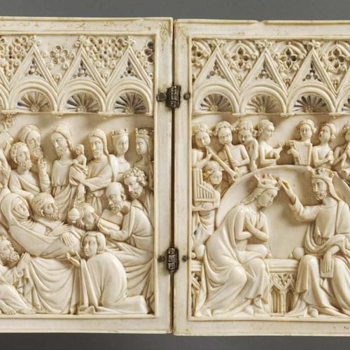 Carved ivory diptych representing the Entry of Christ in Jerusalem. Under three …