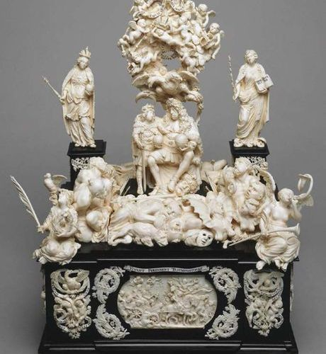 Large stepped altarpiece in blackened wood and carved ivory surmounted by a cruc…