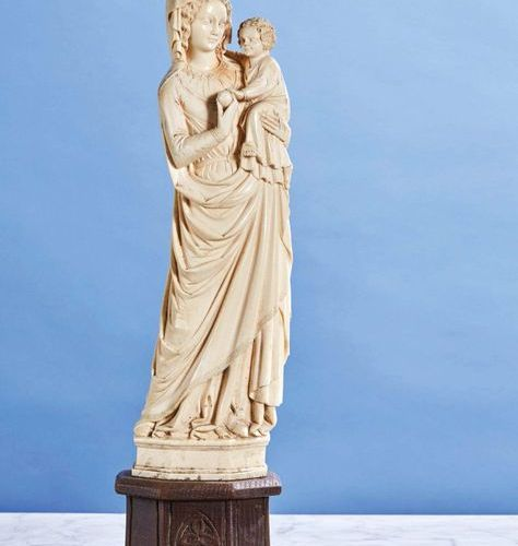 Virgin and Child in ivory carved in the round. On a moulded wooden plinth. In th…