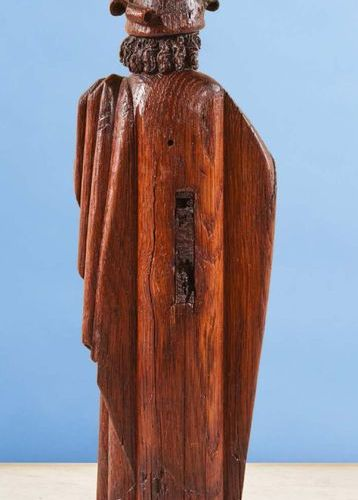 Carved oak prophet. Standing with his left leg forward, he has a phylactery in h…