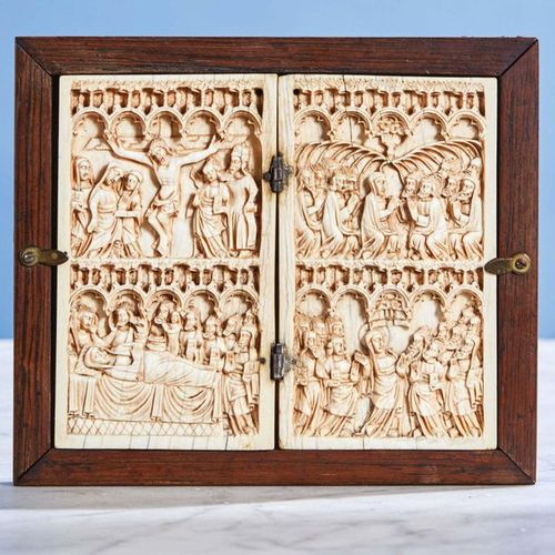 Ivory diptych carved in two registers. Left panel: the Crucifixion and the Dormi…