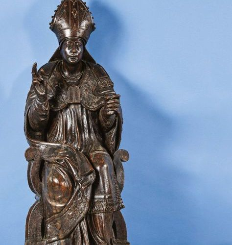 Carved oak Saint Bishop, hollow back. Sitting in a curled armchair, the saint wi…
