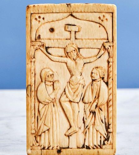 Ivory plaque carved in shallow depth representing the Crucifixion. Under a brack…