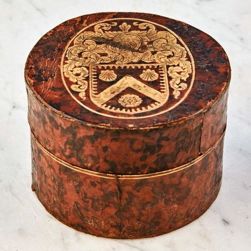 Cylindrical cardboard box, covered with leather gilded with small iron with on t…