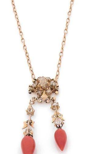 COLLIER en or 18K (750), orné d'un motif formant une fleur stylisée, serti de di…