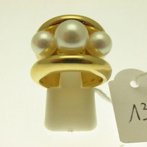 1 large gold mounted ring with a central band adorned with three cultured pearls…
