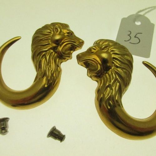 1 pair of gold ear studs decorated with lion heads, bearing the BASSANI signatur…