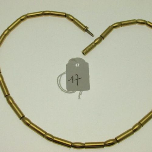 1 gold necklace (resin sheathing) composed of alternating tubular links with ovo…