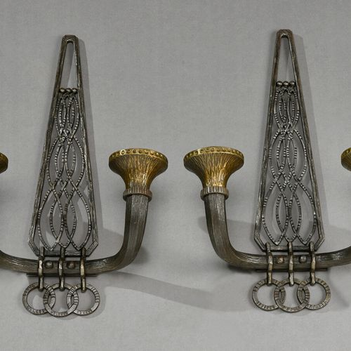 Charles PIGUET (1887 1942)  Pair of wrought iron sconces with two horn shaped li…