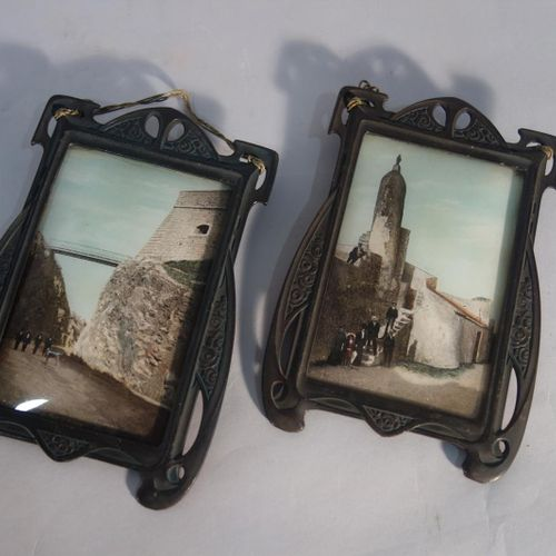 WORK OF 1900  Pair of antique green patinated wrought iron frames with vegetal d…