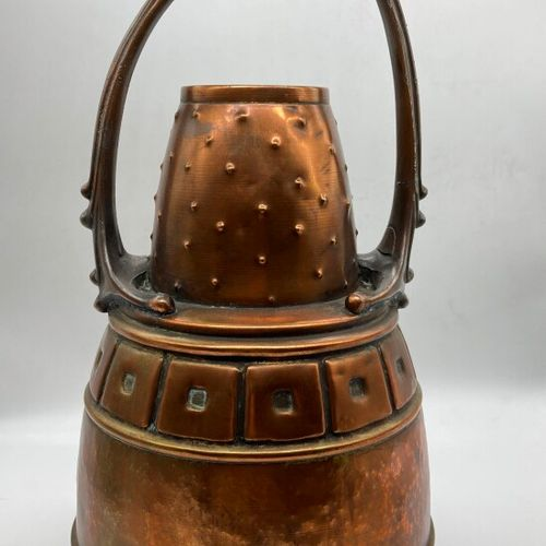 ISIS  A copper and metal jar with a shouldered ovoid body and a conical neck wit…