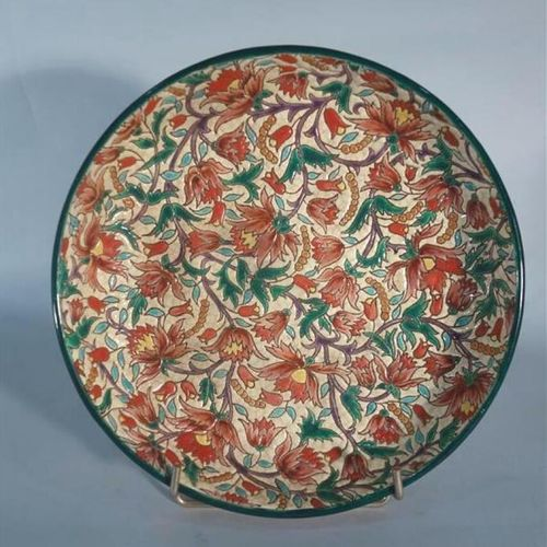 LONGWY  Ceramic bowl with circular body on ring heel. Decorated with flowers in …