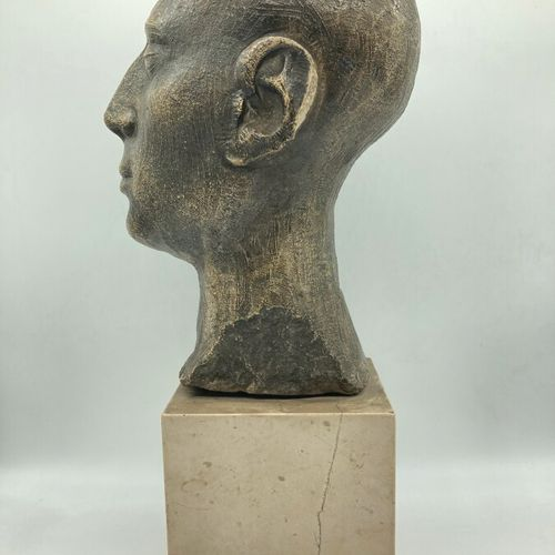 "FRENCH WORK  ""Head of a man"". Sculpture in patinated stone (small accidents) on …"