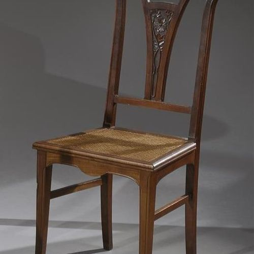 ART NOUVEAU WORK  Two chairs with a flat back carved with stylized flowers in th…