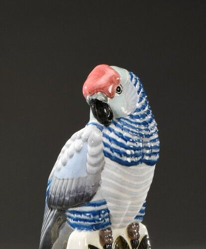 """FRENCH WORK  """"Parrot"""". Proof in polychrome enamelled ceramic.  Height 32,5 cm"""
