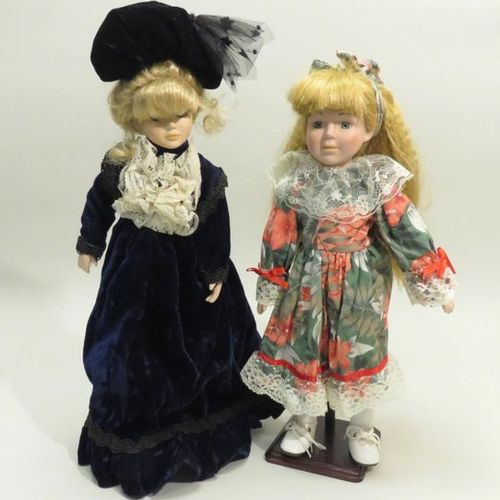 Set of two modern dolls in cloth clothes, the heads, forearms, hands and legs in…