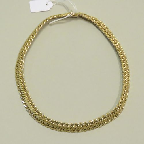 """Important collier en or jaune à mailles tressées. Le fermoir à clapet avec """"huit…"""