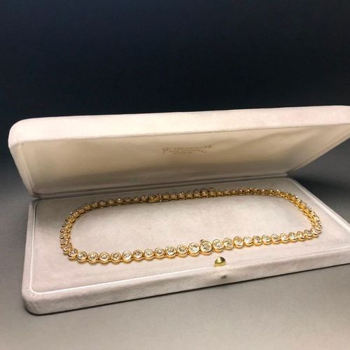 Articulated necklace in 750 thousandths yellow gold set with a line of seventy f…
