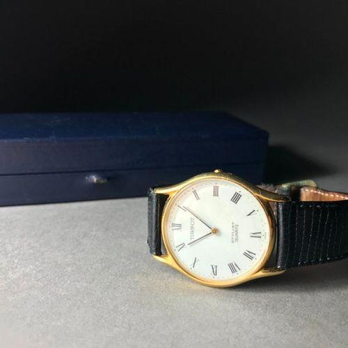 TISSOT 18 carat yellow gold watch Circular case with Roman numerals Quartz movem…