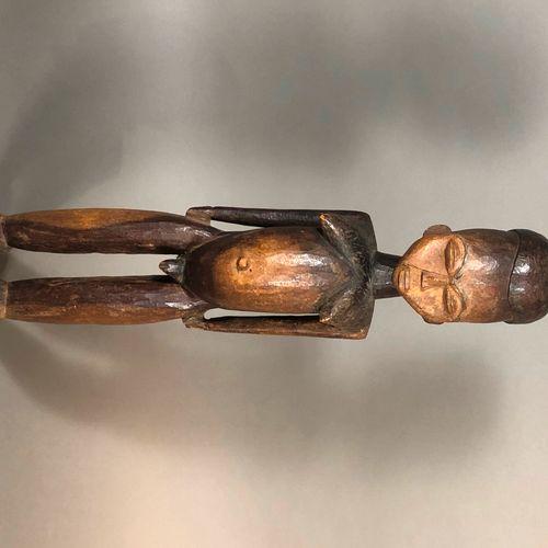 Statue Lobi, Burkina Faso  Bois à patine brune  H. 57 cm    Effigie masculine se…