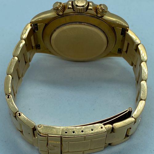 ROLEX ROLEX DAYTONA, CHRONOGRAPHE en or, cadran clair Bracelet en or à fermoir d…
