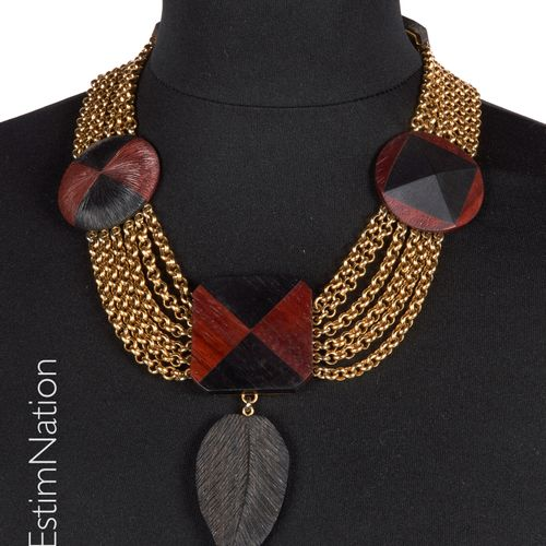 YVES SAINT LAURENT CIRCA 1980/90 NECKLACE made up of gilded metal chains retaini…
