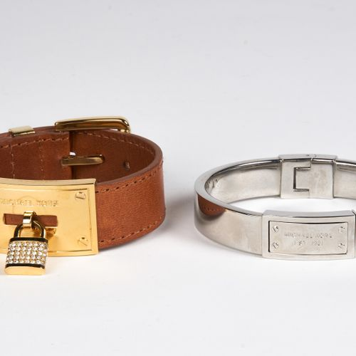 Michael KORS TWO BRACELETS: the first one in natural leather and gold metal, the…