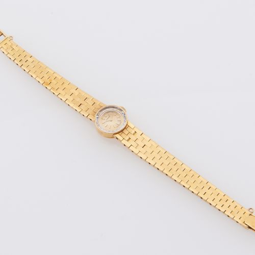 CHAUMET CHAUMET  Watchband in 18K yellow gold (750 thousandths). Round dial, gol…