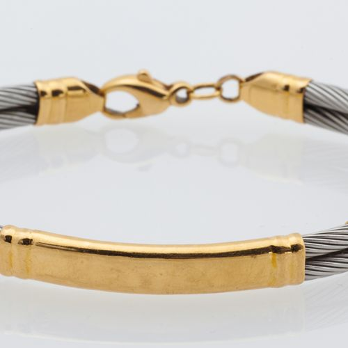 BRACELET ACIER OR Bracelet composed of two steel cables with 18K (750°/00) yello…