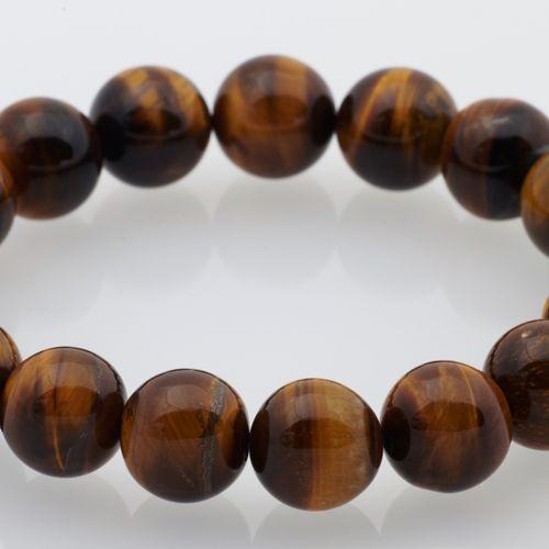 BRACELET OEIL DE TIGRE Stretchable bracelet made of tiger eye beads on elastic t…