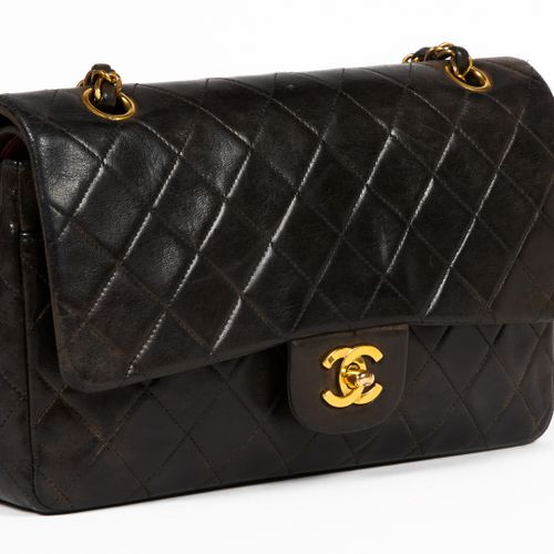 CHANEL circa 1995 BAG with double flap in black padded lambskin leather, leather…