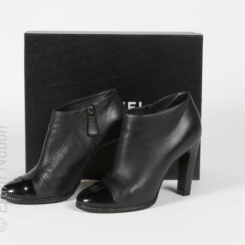 CHANEL (2014) Pair of black aged leather ankle boots, patent toes, signed, rhine…