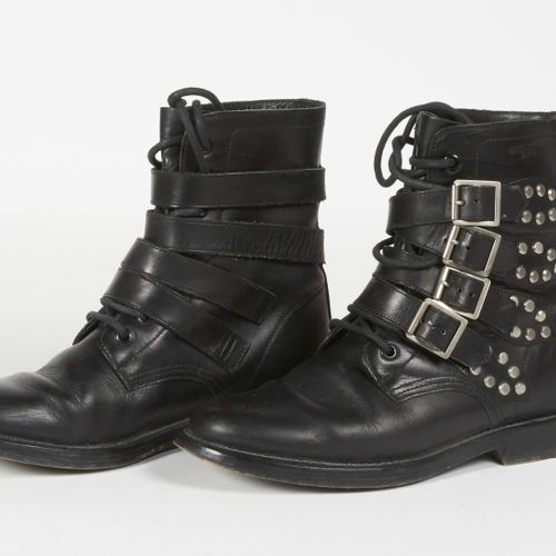SAINT LAURENT Pair of black leather ankle boots, rivets and buckles (P 37) (fold…