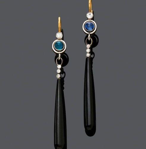 *ONYX, SAPPHIRE AND DIAMOND EAR PENDANTS, ca. 1930. Platinum and yellow gold 585…