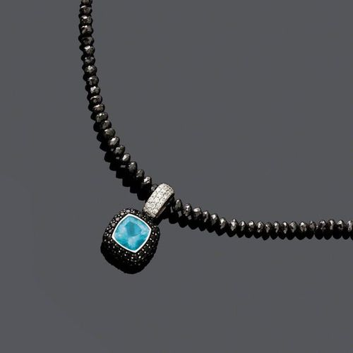 *DIAMOND AND TOPAZ NECKLACE. White gold 750, 8g. Designed as a line of facetted,…