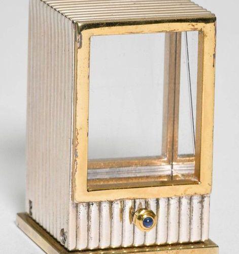 """Cartier, decorative and rare miniature table clock """"Pendule Mystérieuse Prisme"""",…"""
