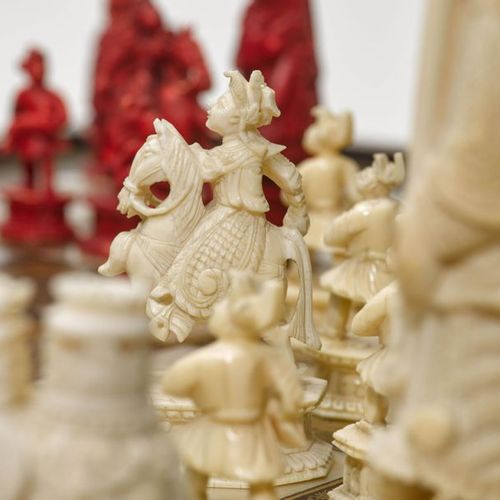 A LACQUER CHESS BOARD AND COMPLETE IVORY CHESS SET. China, 19th c. 56.3 × 56.3 c…