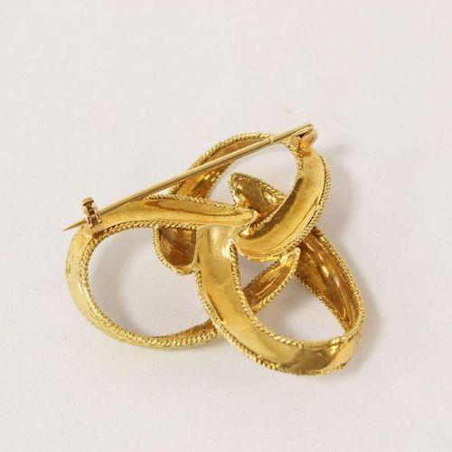 Broche BROCHE en or jaune (750) en forme de noeuds.  Poids brut 13,75g Diam. 4 c…