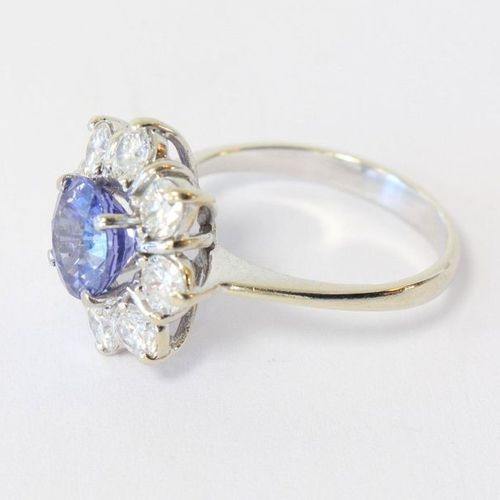 Bague Daisy ring in white gold (750) set with a brilliant cut sapphire probably …