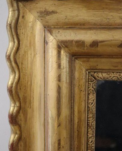 GRAND MIROIR LARGE rectangular MIRROR in a moulded and gilded wooden frame.  Ove…