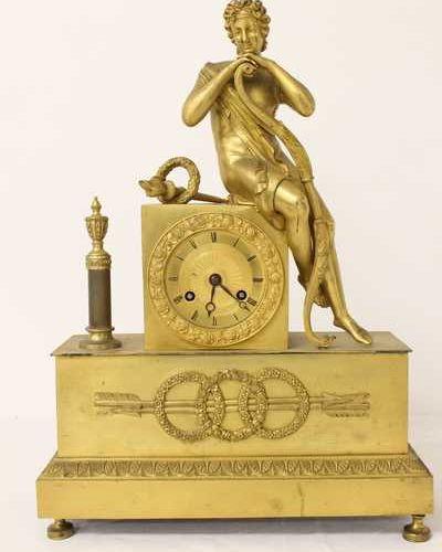 PENDULE BORNE HANGING HANGER in gilt bronze representing a figure in Antiquity w…