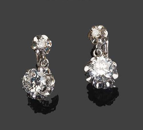 Pair of earrings in white gold, set with four diamonds, two of which are larger …