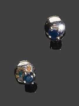 Pair of white gold earrings, set with two small round faceted sapphires Pb: 1.55…