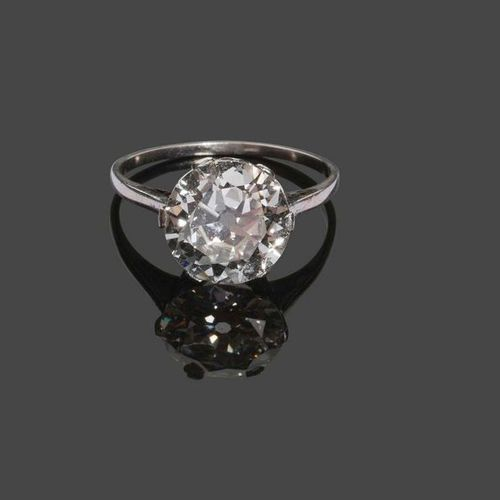White gold ring set with a diamond weighing 3.96 carats. The diamond is accompan…