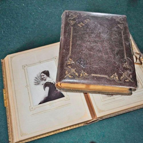 2 photo albums circa 1880 1900 in gilded leather with irons, brass coat of arms.…