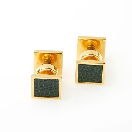 HERMES, Pair of cufflinks in gold metal and green lizard leather. Signed, in its…