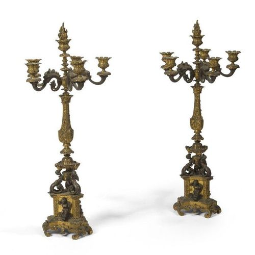Pair of CANDELABRES IN THE TASTE OF RENAISSANCE in patinated and gilded bronze, …